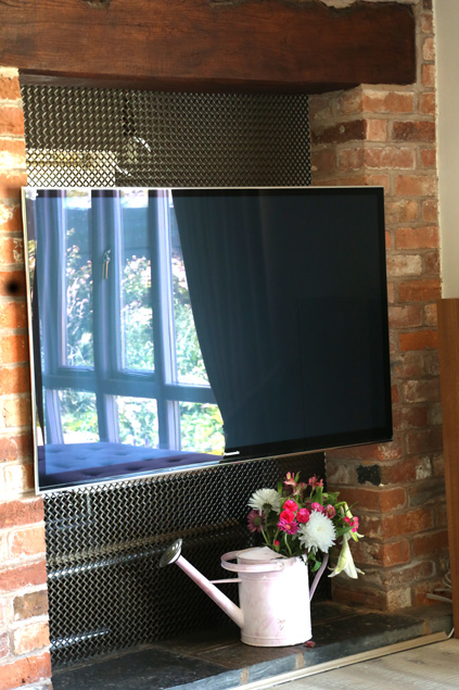 tv components hidden by mesh grille
